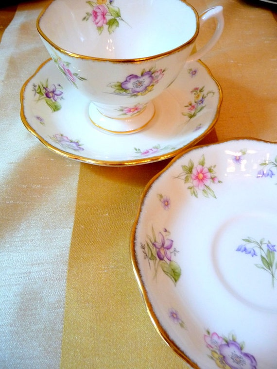 Royal Albert China Teacup and saucers  with pink floral motif and gold scalloped edges, lovely