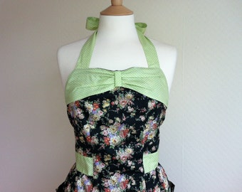 Retro apron with bow, floral pattern on a black fabric. 1950s vintage inspired, fully lined.
