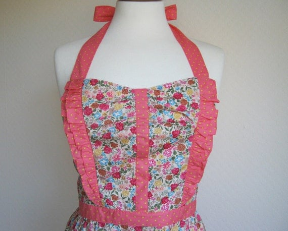 Special offer. Retro apron with side ruffles, pink and blue flowers, yellow polka dots on coral fabric, fully lined