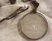 beautiful vintage opticians lens necklace