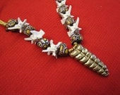 Necklace with Rattlesnake rattle, vertebrae, and African trade beads