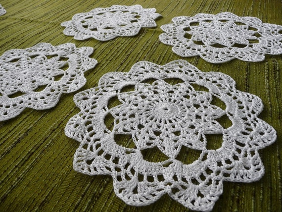 Set of four crochet white doilies