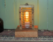 Found Wood and Metal Artifact With Vintage Style Light Bulb With an Antique Cheese Slicer Screen Lamp