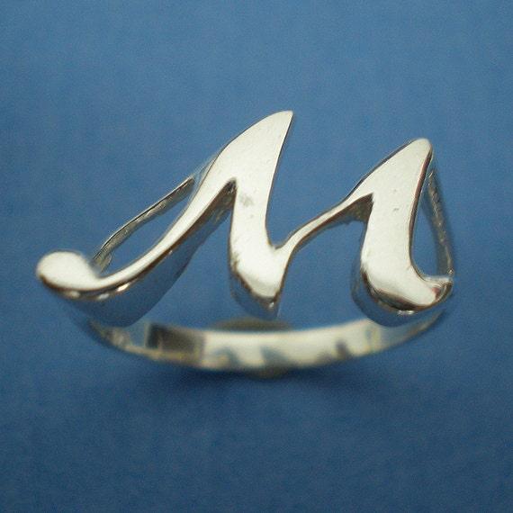 M Letter In Ring Cursive Alphabe...