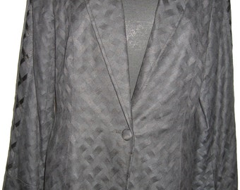 Patterned Black silk/ cotton jacket with crisscross ribbon detail on sleeves