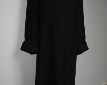 Elegant 1950's black wool coat with raglan sleeves