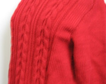 Handknitted classic red wool pullover