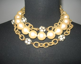 1980's 3 stranded choker of faux pearls and gold link chain with spherical rhinestone beads.