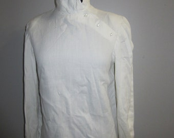 Vintage white cotton pique blouse with high collar, diagonal closing and long pleated sleeves
