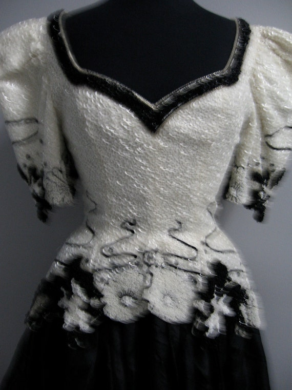 1980's grand beaded black and white ball gown with big sleeves and peplum by Fabrice couture