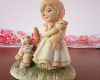 Figurine Of Girl And Her Pet Squirrels