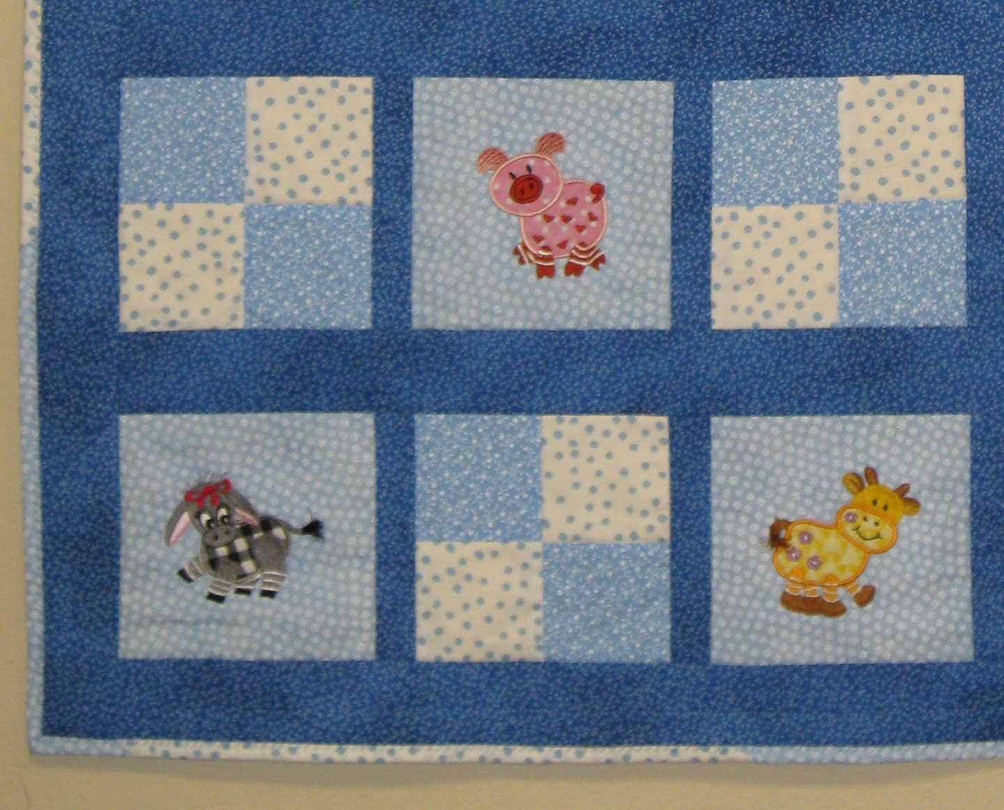 Custom embroidered farm animal baby quilt