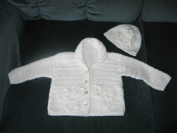 Crocheted baby sweater and hat