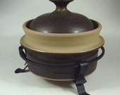 Scandinavian pottery casserole with wrought iron stand