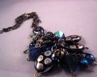Mightnight Carnival Kittangle Kascade silver chain, silver and blue wire, blue glass and plastic beads OOAK