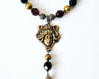 Lady Goddess art deco nouveau face pendant necklace in dark garnet red, black and antique gold