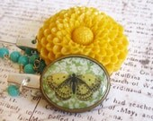 Beautiful large yellow flower and butterfly sweater clips with blue beaded chain