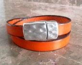 Double orange leather bracelet with zamak magnetic clasp