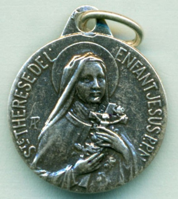St. Theresa Silver Religious Medal on 18 inch sterling silver rolo chain