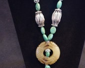 Turquoise necklace with carved agate pendant