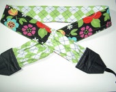 Fresh Limes in a Funky Garden Camera strap, reversible, 2 expandable pockets with stretchable elastic.