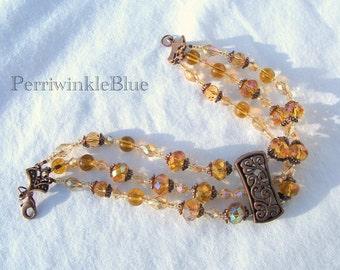 Triple Strand Bracelet, Antiqued Copper with Amber and Biege Crystals, Isabel at Sunset