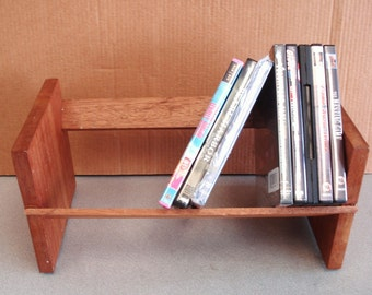 Wooden Surface top Books DVDs Rack.
