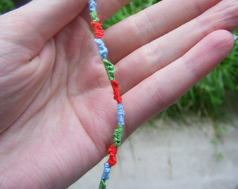 Red, green and blue friendship bracelet.