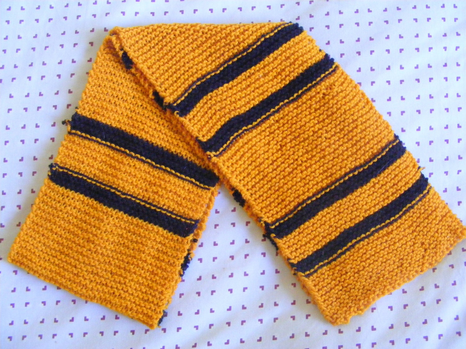 Hand-knitted Hufflepuff scarf.