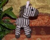 Zena the Zebra. Beautifully made amigurumi Zebra. Perfect for a child's nursery.