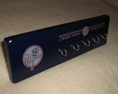 """New York Yankee key rack """" hangup """" (50% off with purchase of any  """"sports series coat rack"""") at regular price."""