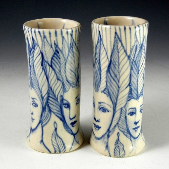 Blue and white faces bud vase pair