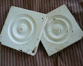 Shabby cottage architectural salvage rosettes--nice and chippy pair