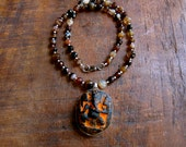 Agate stones of varying shades of Brown with Glass Ganesha