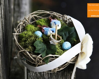 Handmade bird nest ring bearer (pillow) with two lovebird and blue eggs.