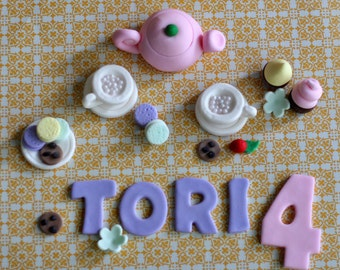 Fondant Tea Set, Tea Cups, Cookies, Cupcakes, Flowers and the Birthday Kid's Name and Age Cake Decorations