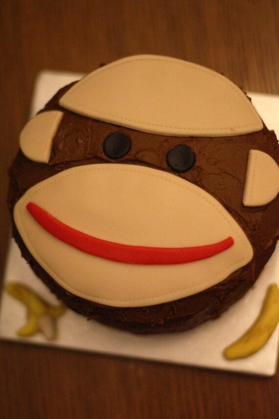 Fondant sock monkey face and bananas for decorating a birthday - Banana cake decoration ...