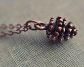 petite pine cone necklace.