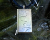 Abstract watercolor pendant in tones of sky blue and pale green