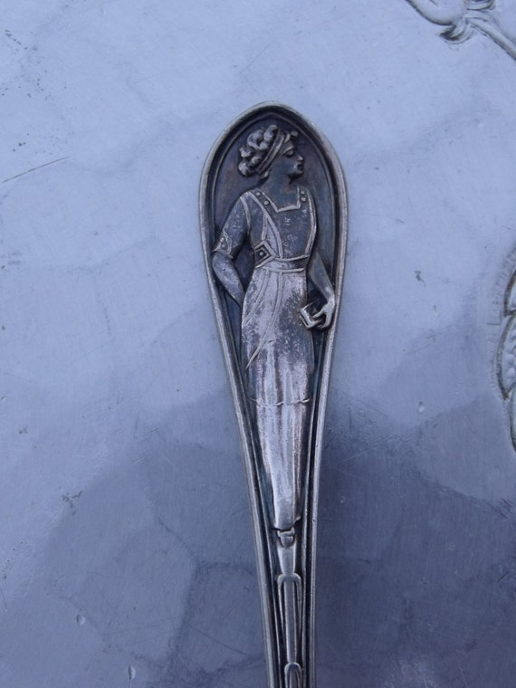 """Highly collectible unique silver plated tea spoon of ROGERS & Son  with engraved world globe and beautiful women ,6""""L"""