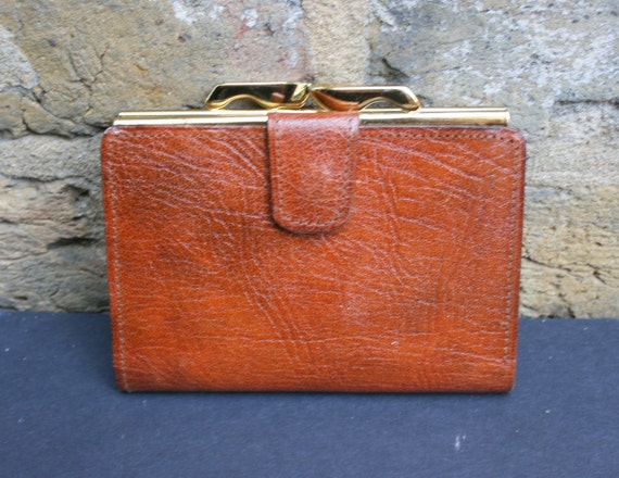 Vintage leather purse with metal clasp