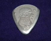 Silver Peso guitar pick one of a kind