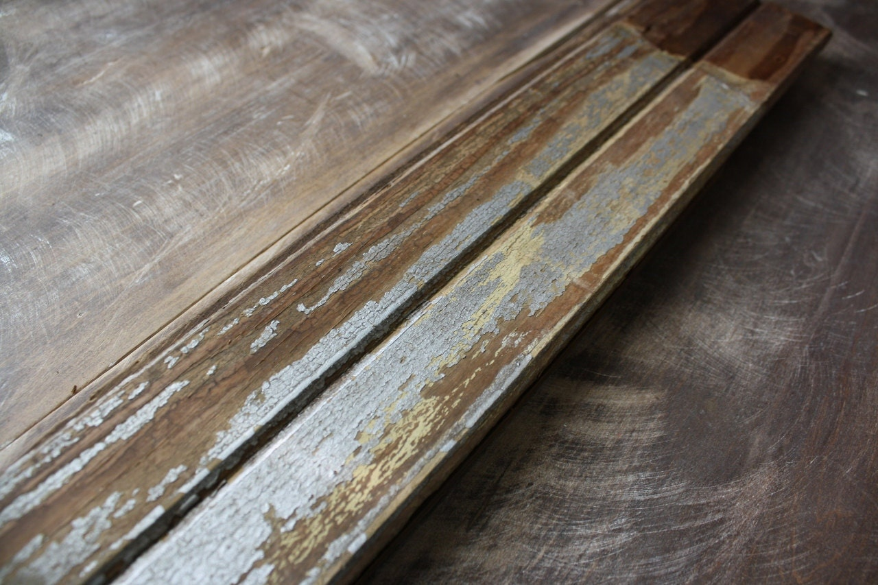 reclaimed wood trim with distressed metallic silver paint. Black Bedroom Furniture Sets. Home Design Ideas