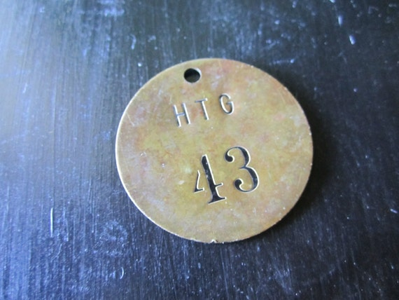 Brass tag Number Forty Three