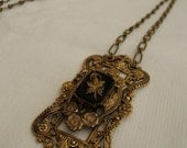 Vintage gold and black ornate necklace