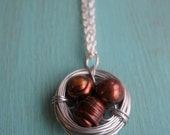 Brown birds egg nest necklace