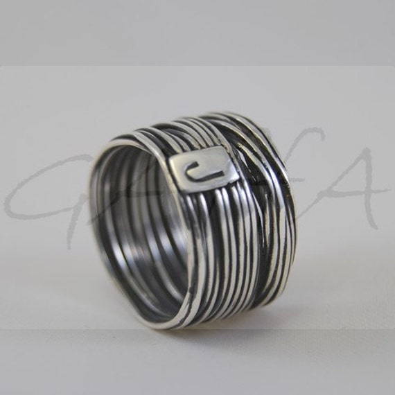 Silver ring with initial letter