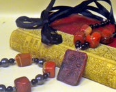 Handmade Necklace and bracelet set with completely handmade Polymer clay pendant, red jasper, hemotite and black glass beads.