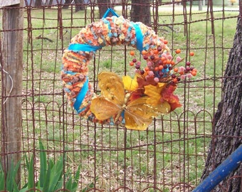 Colorful Yarn Wreath with Gold Butterfly and Turquoise Ribbon