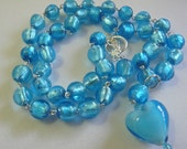 handcrafted bright turquoise blue glass bead necklace